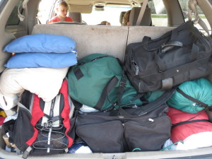 What we pack: green duffle bag with kids' clothes, black bag with my clothes, some small pillows, a couple sleeping bags, black garment bag in the bottom with our dress-up clothes, and a backpack for a lap top.