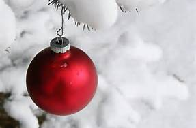 red christmas ornament and snow