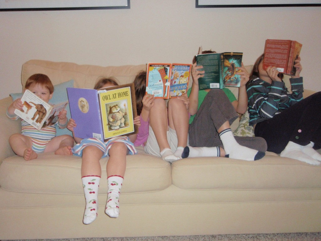 My children humored me by posing for this picture. They don't actually read lined up like this.